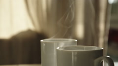Cup with hot beverage Stock Footage