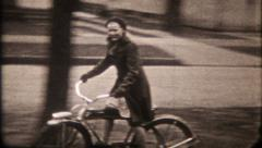2663 - young girl rides bicycle on suburban sidewalk - vintage film home movie Stock Footage