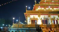 4K. Time Lapse Landmark Light waving of candle rite walk at Wat Nongwaeng, Stock Footage