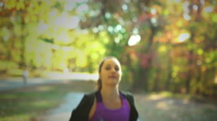 Woman running in a Park Stock Footage