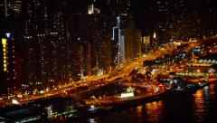 Nighttime Cityscape with Towers, a Major Highway and a Harbor Stock Footage