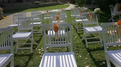 Chairs on the grass for a banquet Stock Footage