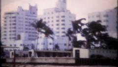 2659 - Miami Beach hotels & tourist on beach - vintage film home movie Stock Footage