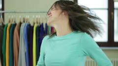 Stock Video Footage of Young woman flicking long dark hair,  slow motion HD