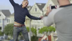 Man Takes A Photo Of His Boyfriend Jumping In Air For Vacation Photo Stock Footage