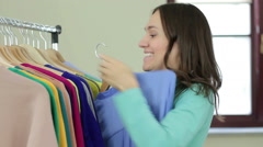 Shopaholic shopping woman with clothes rack HD Stock Footage