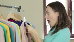 Portrait of happy woman holding price tag at a boutique HD Stock Footage