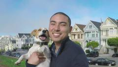Asian Man Uses Gopro Stick To Take Portrait With His Dog In San Francisco Stock Footage