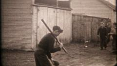 2664 - boys play baseball in the neighborhood alley - vintage film home movie Stock Footage