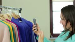 Woman taking a photo of new blouse in fashion boutique HD Stock Footage