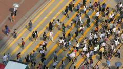 Stock Video Footage of People crossing street in Causeway Bay, Hong Kong. View from above.