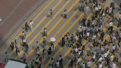 People crossing street in Causeway Bay, Hong Kong. View from above Stock Footage