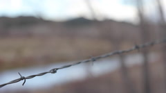 fence and stream focus dissolve stabbing shot with water - stock footage