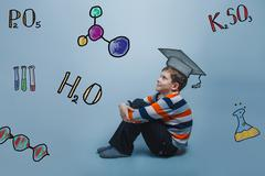 teacher boy chemistry teenage student he is sitting pretty think - stock photo