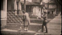 2670 - children sweep & rake leaves in frontyard - vintage film home movie Stock Footage