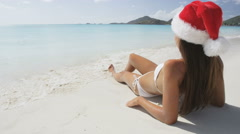 Beach christmas vacation holidays travel concept – woman in Santa hat Stock Footage