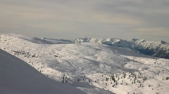 View to free terrain at snowy slope in Alps ski resort. Dark green trees Stock Footage