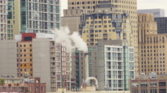 Steam Chimney On Modern Generic City Buildings - stock footage