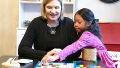 Home School Mom Using Counting Blocks During Lesson Stock Footage