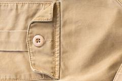 Front pocket on brown shirt textile texture background Stock Photos