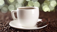 White cup of coffee on coffee beans with a spoon prevent sugar Stock Footage
