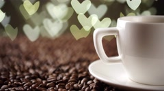 White cup on the coffee beans on the background of hearts Stock Footage