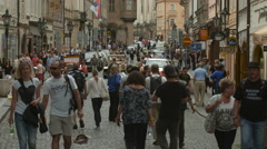 Tourists walking on Mostecka Street in Prague Stock Footage