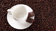 Coffee poured in a white cup on the coffee beans Stock Footage