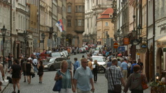 People walking on Mostecka Street in Prague Stock Footage