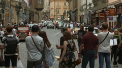 Making soap bubbles on Mostecka Street in Prague Stock Footage