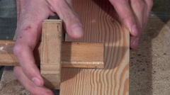 Tracing and drilling of a wooden board - stock footage