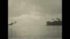 Stock Video Footage of Vintage 16mm film, 1937, Caribbean, island pan, partial sukn sailboat