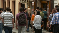 Young adults and adults walking on a street in Mala Strana, Prague Stock Footage