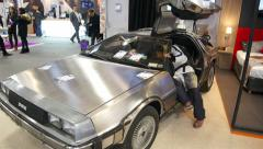 Delorean Dmc Car, Inspired By The Movie Back To The Future In An Indoor Show Stock Footage