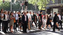 Crowd waiting and crossing road Stock Footage