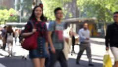 Busy crosswalk intersection pedestrians Stock Footage
