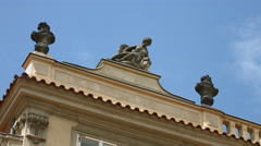 Woman statue on top of a building in Prague Stock Footage