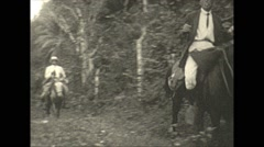 Vintage 16mm film, 1937, Caribbean, well dressed men on horseback Stock Footage