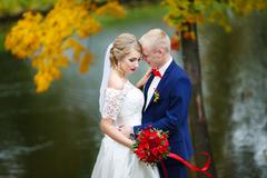 Stock Photo of Autumn wedding emotions