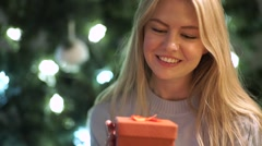 Beauty girl holds a Christmas gift in hands Stock Footage