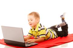 Stock Photo of Education, technology internet - little boy with laptop
