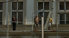 Working on a scaffolding in Prague - stock footage