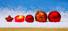 Red Christmas balls and Advent candle . - stock photo