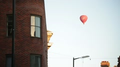 Air Balloon flying above English City pan Stock Footage