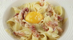 Pasta carbonara with parmesan, egg yolk and bacon, closeup Stock Footage