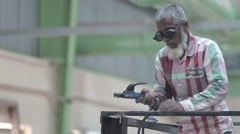 Indian old man cutting steel with the help of welding machine. Stock Footage