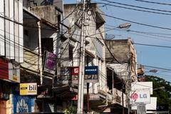 Stock Photo of Billboards and communications cables on Manado street