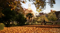 Church in golden leaves, Reading, Europe Stock Footage