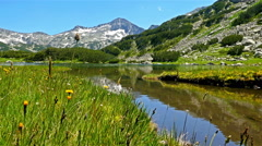 Low angle shot of a beautiful lake in the mountain Pirin, Bulgaria Stock Footage