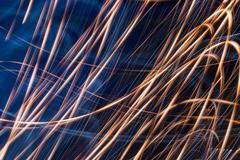 Stock Photo of Brightly colored lightpainting swirling abstract backgrounds with a black bac